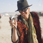 Using tiny hand held cameras the cast of 'As The Dust Settles' records their Burning Man experience. All photos by Mike Hedge.